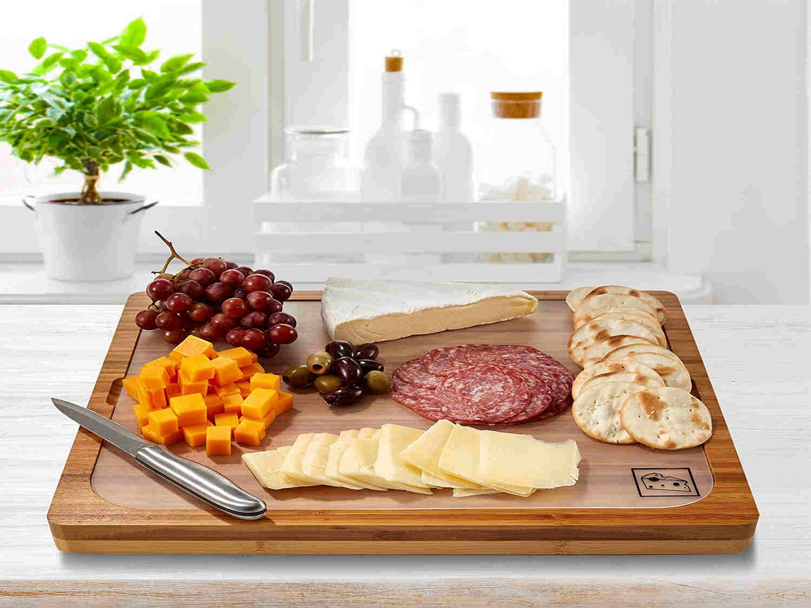 A wooden cutting board with fruits and meat